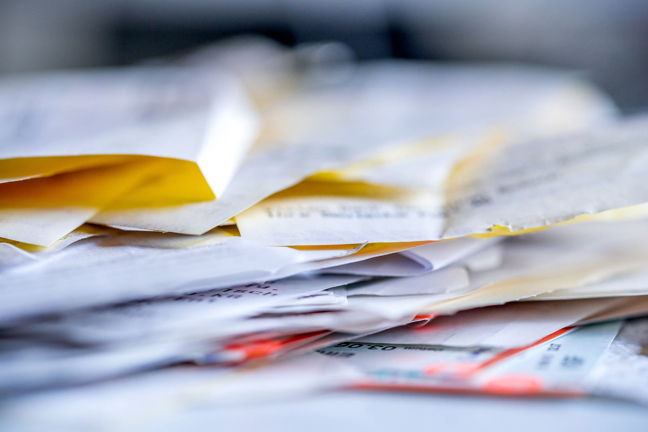My Bookkeeping Resource in Thousand Oaks showing stack of bills and receipts.
